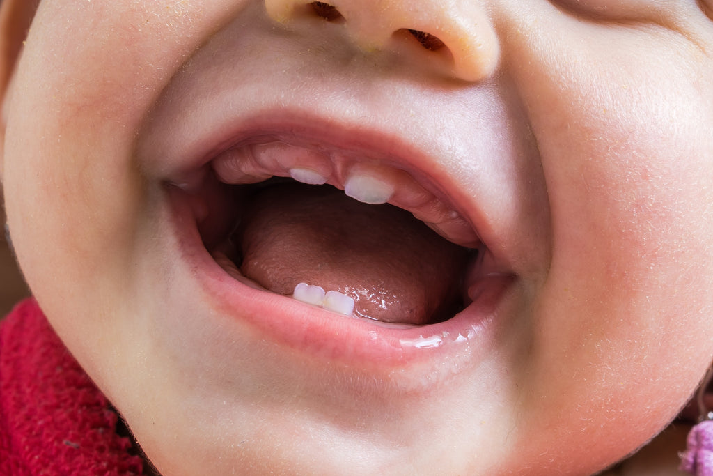 6 Signs Babies Get Their First Tooth
