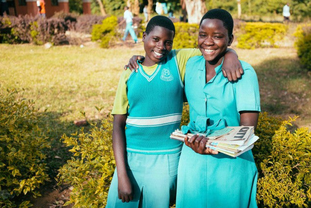 Uganda: High school scholarship program for orphans striving toward sustainability thanks to tuition-paying students; recent harvest success