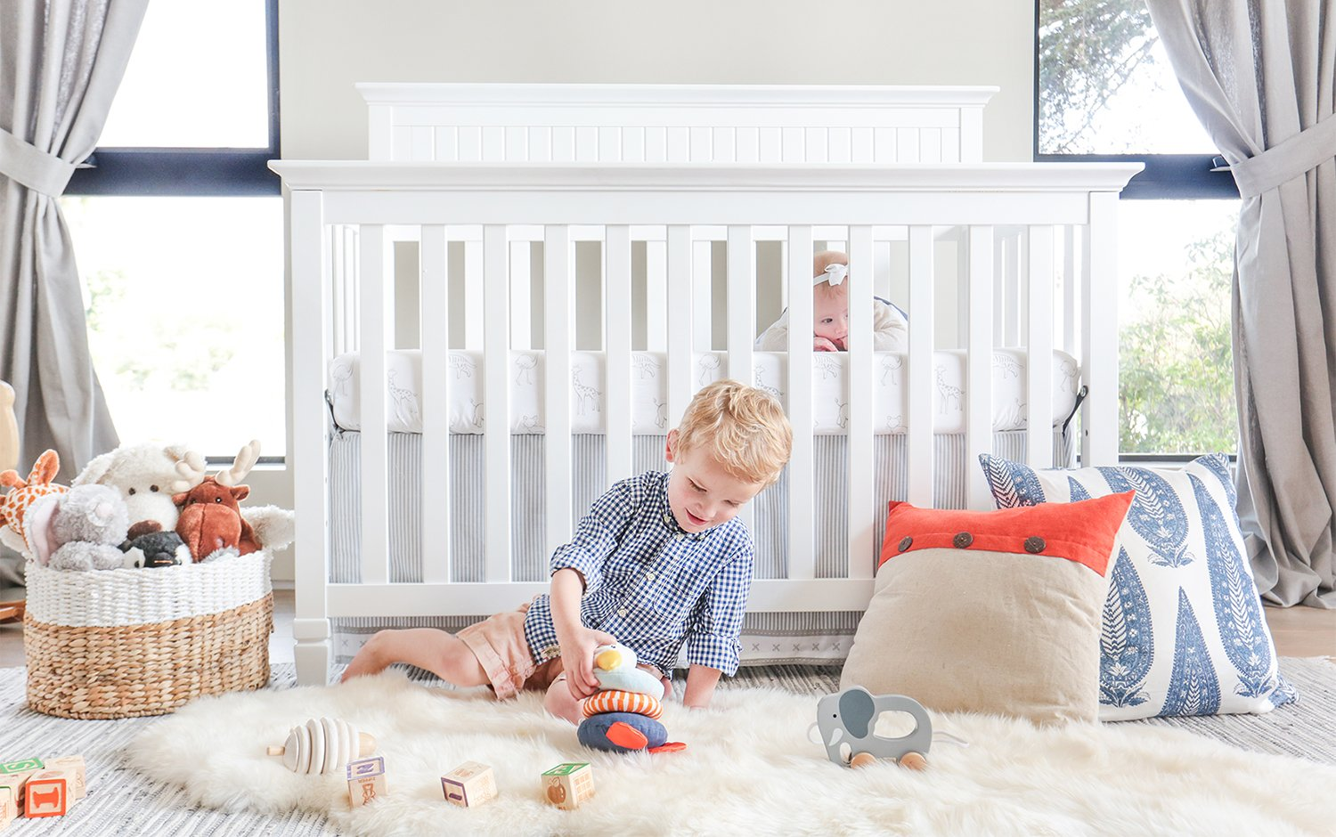 boy in front of crib