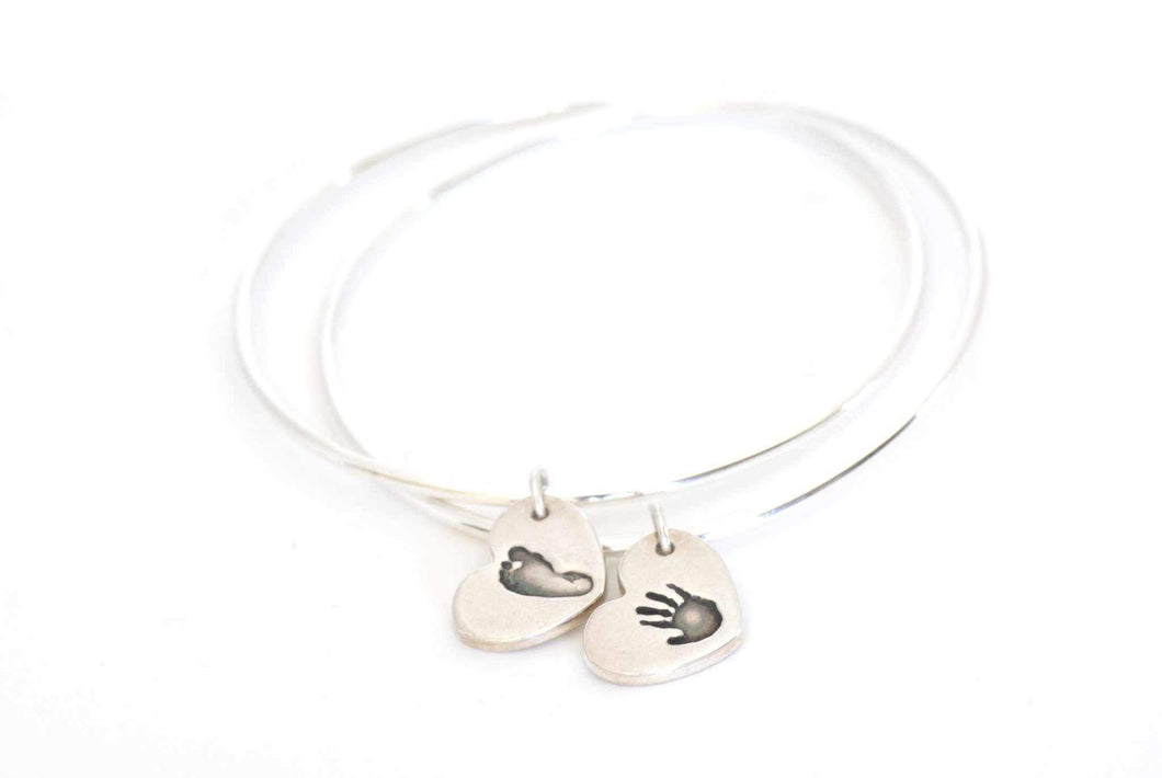 Two Heart Shaped Handprint Charms on an Eternity Charm Bracelet - Handprint Jewelry