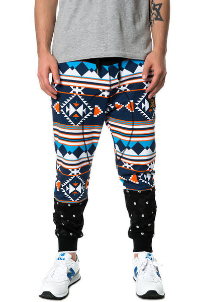 The S.Q.Z. Multi ColorAztec Pattern French Terry Long Drop Crotch Pants with Bottom Cut Block