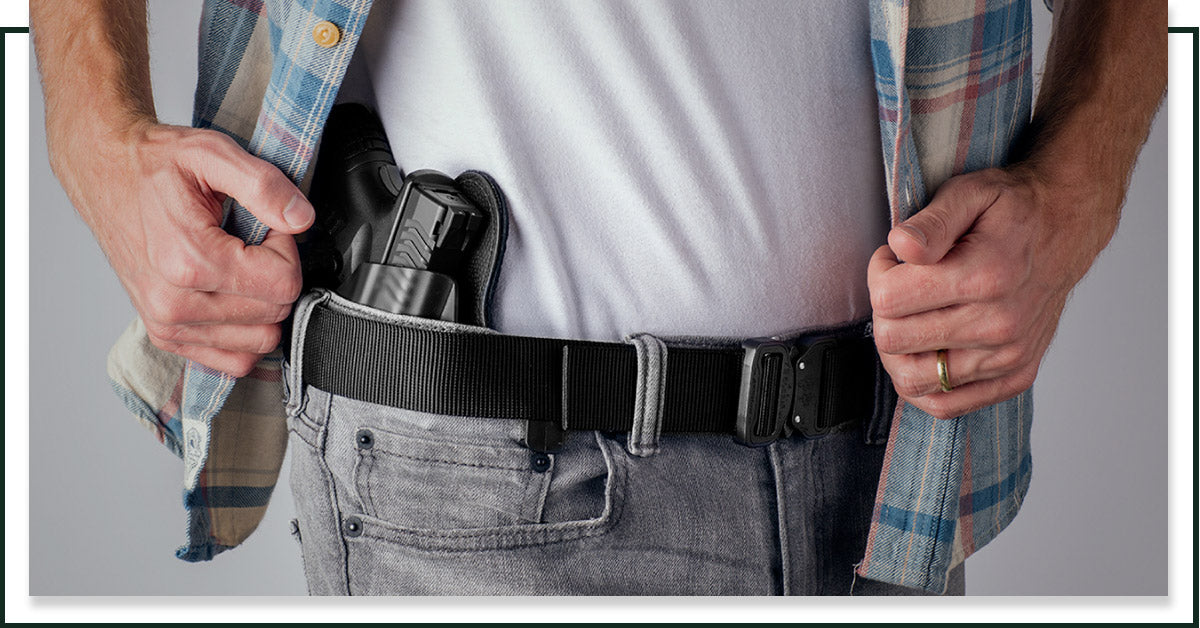 Image of a man concealed carrying with a gun belt from Klik Belts.