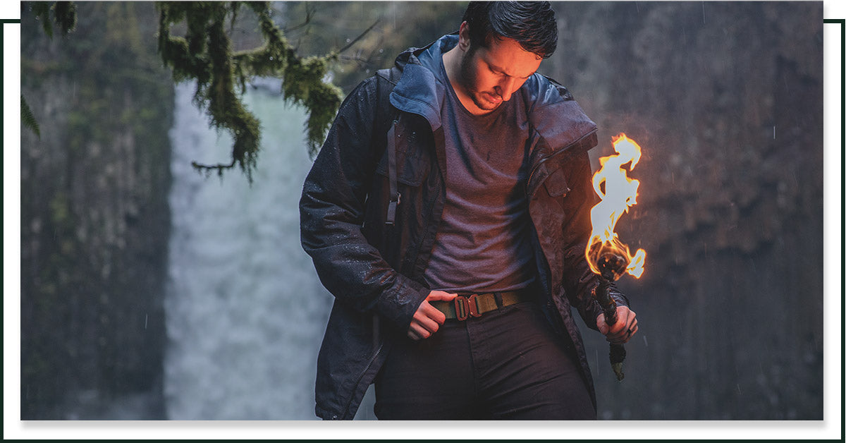 Image of a man in the woods wearing a tactical belt from Klik Belts.