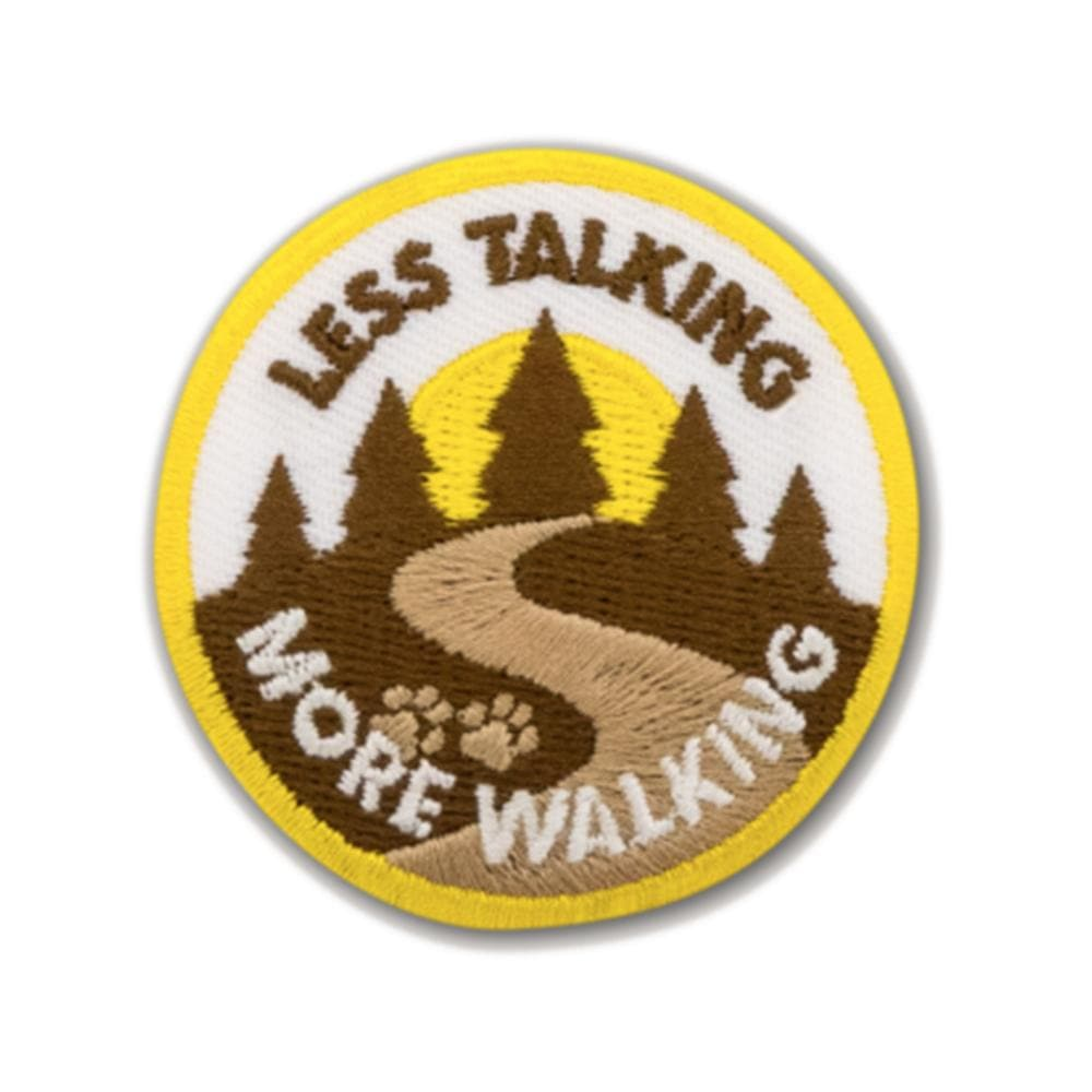 Less Talking More Walking badge Woof & Wild
