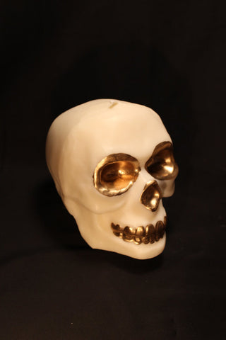 gilded skull candle