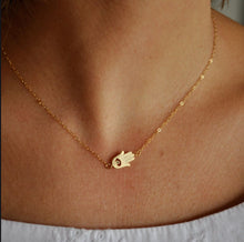 sideways gold hamsa necklace