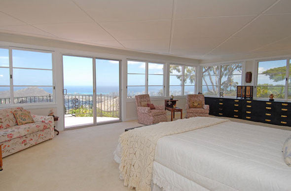Master Bedroom With Glass Wall And Ocean
