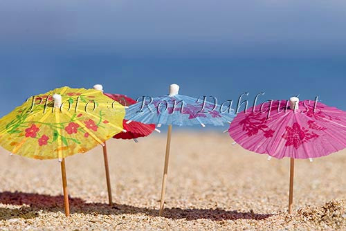 Colorful cocktail umbrellas in the sand, Hawaii Picture