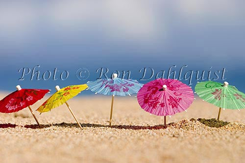 Colorful cocktail umbrellas in the sand, Hawaii