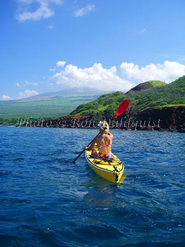 Woman kayaking on the southern coast of Maui near Makena, Maui, Hawaii Photo