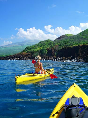 Woman kayaking on the southern coast of Maui near Makena, Maui, Hawaii - Hawaiipictures.com