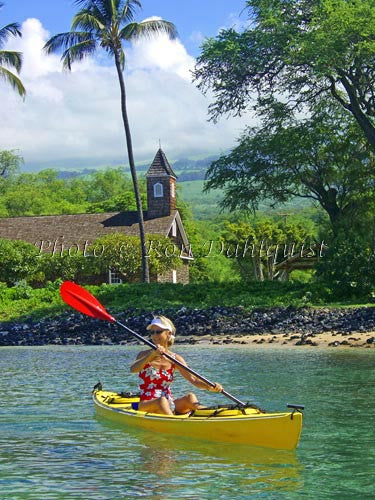 Woman kayaking on the southern coast of Maui, Keawalai Church in background, Maknea, Maui, Hawaii