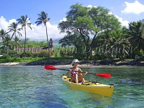 Woman kayaking on the southern coast of Maui, Keawalai Church in background, Maknea, Maui, Hawaii Picture - Hawaiipictures.com
