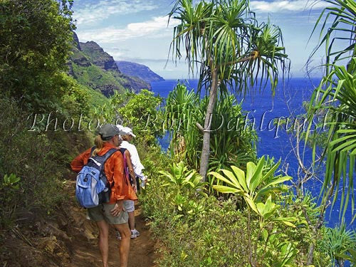 Hikers on the Kalalau Trail which runs along the Na Pali coast. Kauai, Hawaii