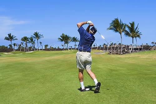 Man golfing on the Mauna Lanai Golf Course, Big Island of Hawaii