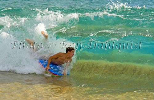 Teenager body boarding in the waves at Big Beach, Oneloa Beach, Makena, Maui, Hawaii