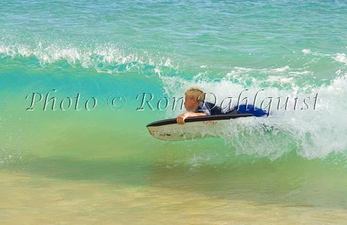 Teenager body boarding in the waves at Big Beach, Oneloa Beach, Makena, Maui, Hawaii Picture