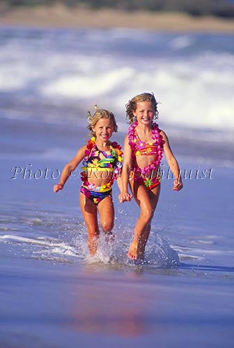 Young girls running on the beach, Maui, Hawaii