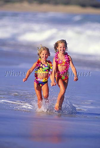 Young girls running on the beach, Maui, Hawaii - Hawaiipictures.com