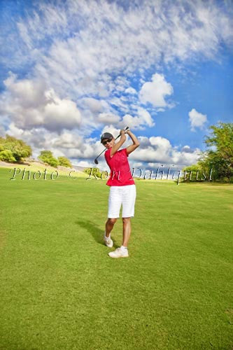 Woman golfing on The Challenge at Manele Golf Course, Lanai, Hawaii Picture