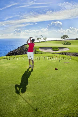 Woman golfing on The Challenge at Manele Golf Course, Lanai, Hawaii