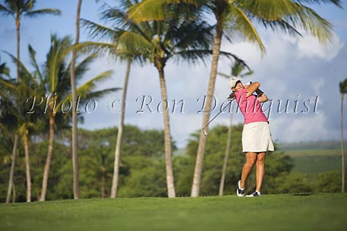 Woman playing golf in Maui, Hawaii Picture Photo Stock Photo