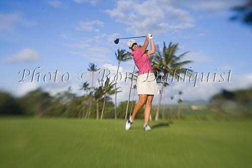 Woman playing golf in Maui, Hawaii Photo