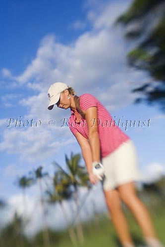 Woman playing golf in Maui, Hawaii Picture Photo
