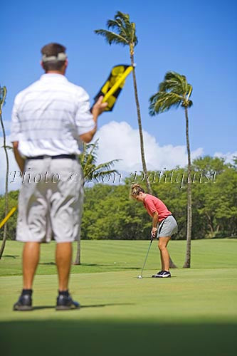 Couple playing golf, Maui, Hawaii Picture Photo