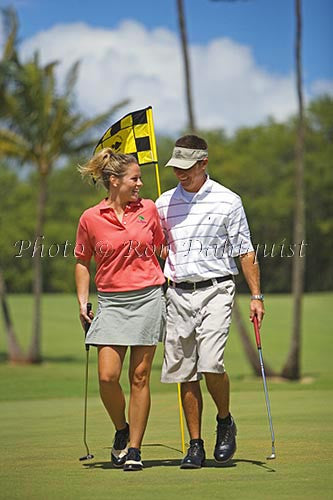 Couple playing golf, Maui, Hawaii