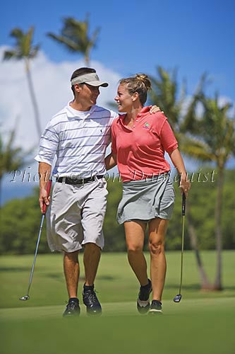 Couple playing golf, Maui, Hawaii Picture