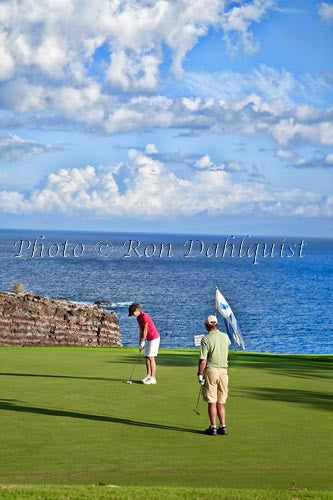 Woman golfing on The Challenge at Manele Golf Course, Lanai MR Photo