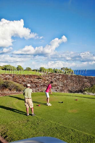 Woman golfing on The Challenge at Manele Golf Course, Lanai MR - Hawaiipictures.com