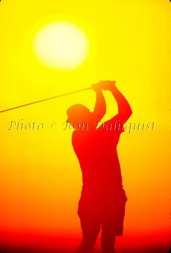 Silhouette of golfer at sunset, Hawaii