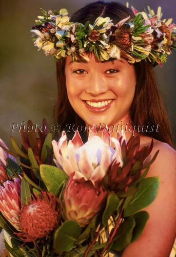 Lovely teenage girl on Maui with bouquet of protea flowers and Haku lei, Hawaii