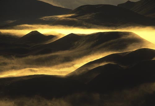 Clouds rolling in at sunrise, Haleakala Crater, Maui, Hawaii