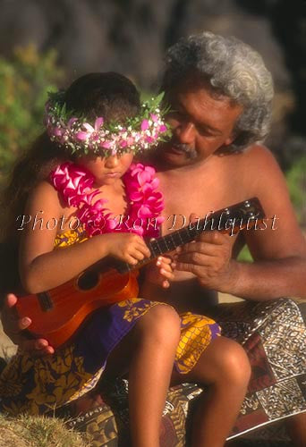 Father teaching daughter to play the ukulele, Maui, Hawaii