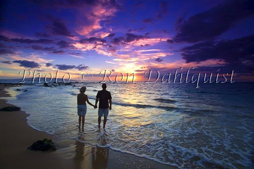 Romantic couple watching a beautiful sunset in Wailea, Maui, Hawaii Picture Photo