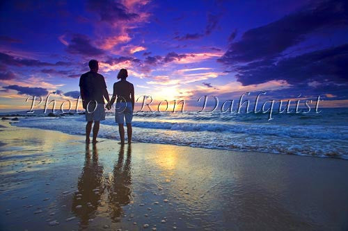 Romantic couple watching a beautiful sunset in Wailea, Maui, Hawaii