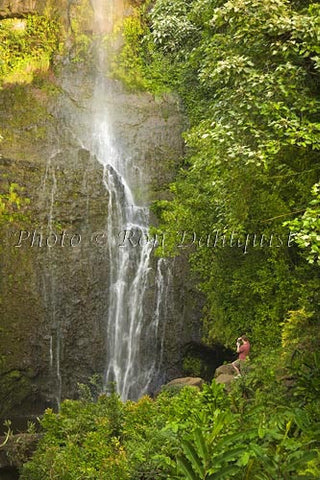 Man taking picture of Wailua Falls, Hana, Maui