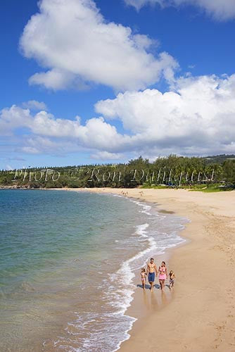 Family walking on Fleming Beach, Kapalua, Maui, Hawaii Picture