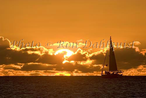 Silhouette of sailboat at sunset, Kauai, Hawaii