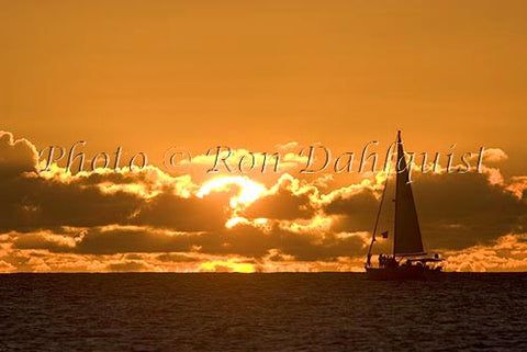 Silhouette of sailboat at sunset, Kauai, Hawaii - Hawaiipictures.com