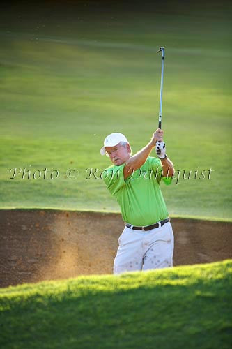 Man blasting out of sand trap, Maui, Hawaii