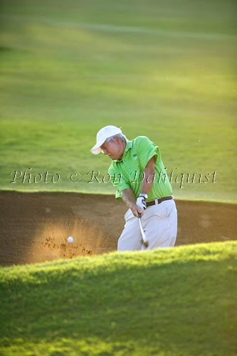 Man blasting out of sand trap, Maui, Hawaii Picture