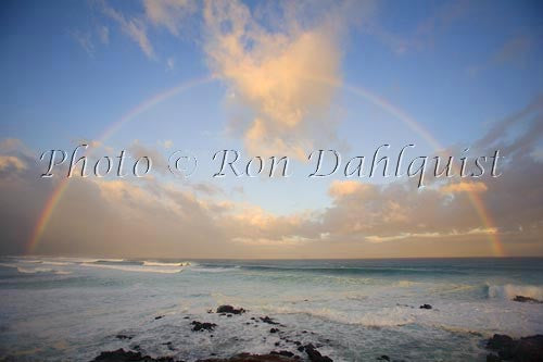 Rainbow at sunrise, waves breaking, Hookipa, Maui Photo