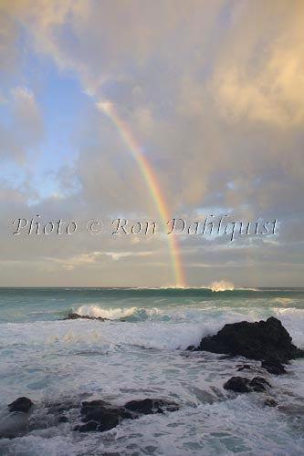 Rainbow at sunrise, waves breaking, Hookipa, Maui Picture Photo