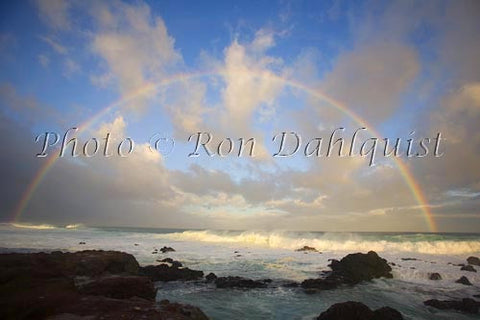 Rainbow at sunrise, waves breaking, Hookipa, Maui