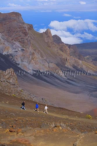 Hikers on the Sliding Sands trail in Haleakala Crater, Maui, Hawaii