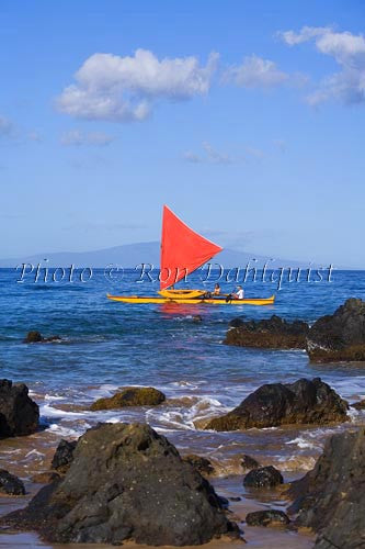 Traditional Hawaiian Sailing Canoe off Wailea Coastline, Maui, Hawaii MR Picture Stock Photo